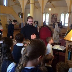 Dn. Teo leads the children of St. Herman's Orthodox School in chanting at a hierarchical liturgy at Holy Resurrection Orthodox Church in Allston, MA